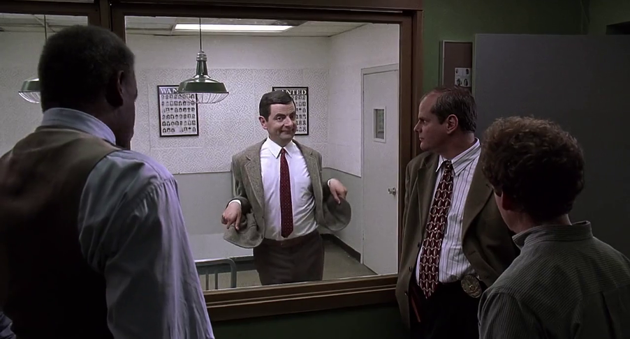 four people in an interrogation room